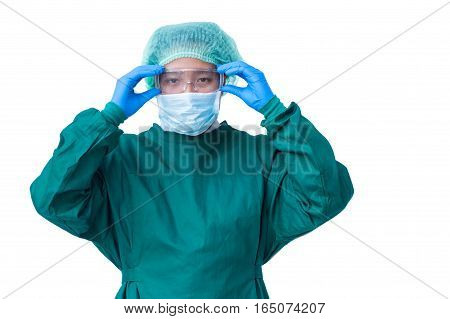 Surgeon preparing for the surgical operation and wearing protective glasses healthcare and safety concept