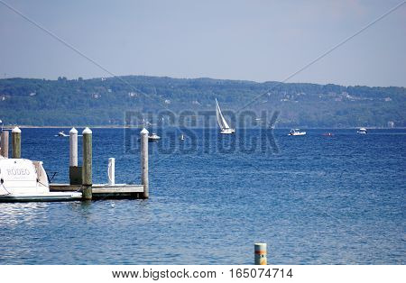 HARBOR SPRINGS, MICHIGAN / UNITED STATES - AUGUST 3, 2016: Boats sail in Little Traverse Bay near Harbor Springs.