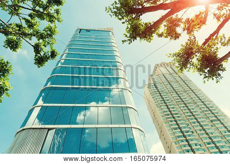 Modern Office Building With Blue Sky Green Trees In Subset.