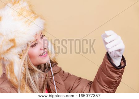 Blonde Woman In Winter Warm Furry Hat