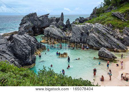 HORSESHOE BAY BERMUDA - MAY 26 - People enjoying a rock enclosed swimming cove at Horseshoe Bay on May 26 2016 in Bermuda.