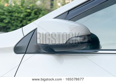 Folding white car side view mirrors. Folding side mirrors Car