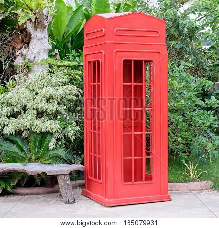 red telephone booth  in the big garden