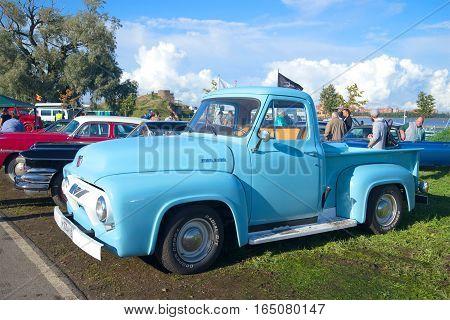 SAINT PETERSBURG, RUSSIA - SEPTEMBER 04, 2016: American Ford pickup F100 1954 model year in the parade of vintage cars in Kronstadt