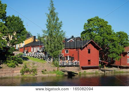 PORVOO, FINLAND - JUNE 13, 2015: A view of summer cafe on the river bank of Porvoyoki in the old city. Historical landmark