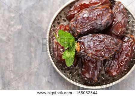 Sweet dried figs dates in a plate on the table