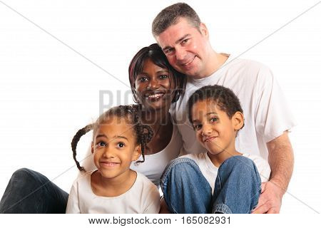 studio shot of african mother, european father and their children.