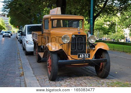 HELSINKI, FINLAND - AUGUST 28, 2016: Truck Ford AA Platform on the streets of Helsinki on August day. Finland