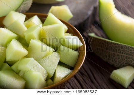 Fresh melon sliced on wooden table. Fresh melon sliced .
