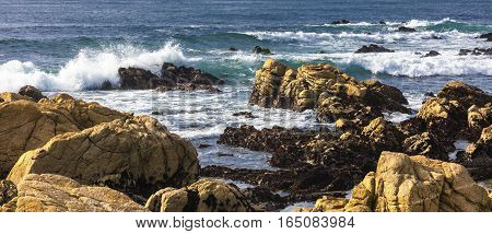 Beautiful Scenery On The Sea Shore, The Waves And Huge Rocks
