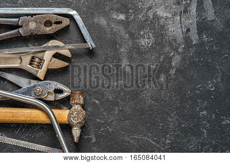 Set of tools on dark cement background with copy space. Suitable as fathers day card.