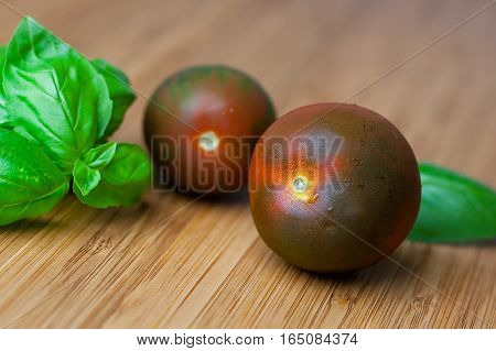 Tomatoes And Basil On The Bamboo Wood Chopping Board