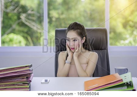 A beautiful young woman with a busy jobyoung woman working a lot documentthe work of a busy girl.