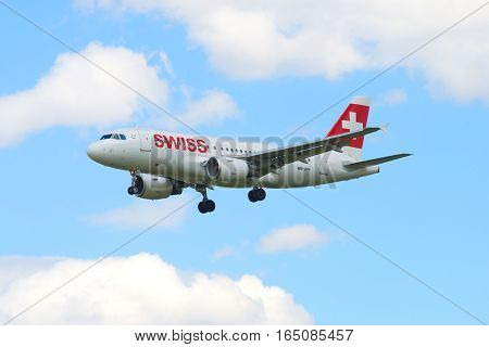ST. PETERSBURG, RUSSIA - MAY 17, 2016: The Airbus A319-112 plane (HB-IPY) Swiss International Airlines flying in the cloudy sky