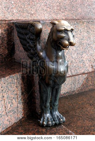 Saint-Petersburg, Russia - September 30, 2016: Bronze sculpture of a griffin at the Academy of Arts on the University embankment in the September 30, 2016 in St. Petersburg, Russia.