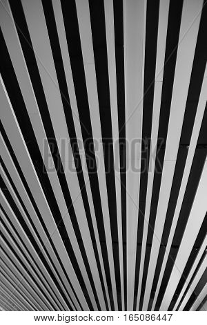 black and white striped background in a buiding.