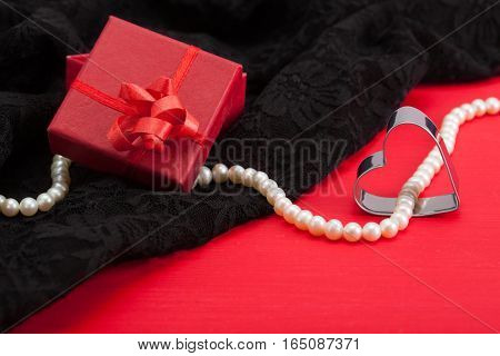Red Gift And White Pearl Necklace On Black Lace Underwear