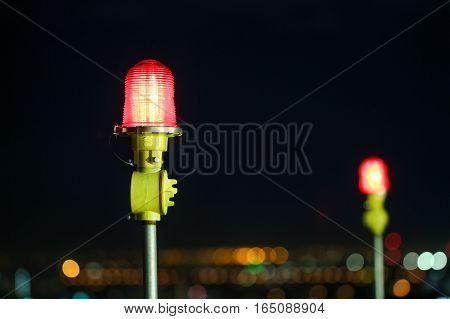 Closeup Of An Aircraft Warning Light On Top Of A Highrise Of Building In Night Time. For Safety Conc