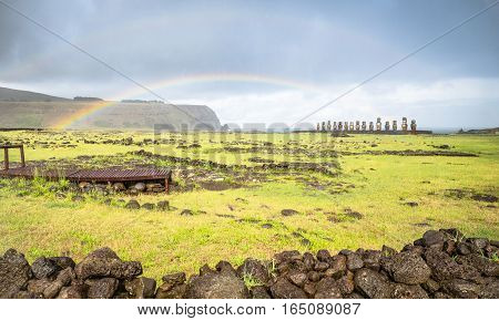 Double rainbow on panoramic view of Ahu Tongariki moai archeological site area on world famous Rapa Nui ( Easter Island ) in Chile - Travel wanderlust concept - Vivid filter on dramatic cloudy sky