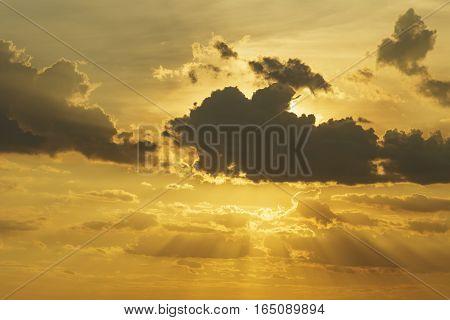 Shade Of Sunlight Behind Dark Cloud Before Sunset