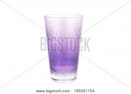 Violet plastic glass isolated on white background.