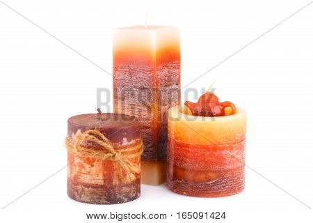 Three colorful candles isolated on white background.