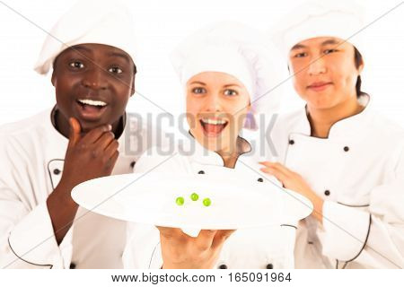 multi-ethnic group of cooks presenting their new creation for people on a diet