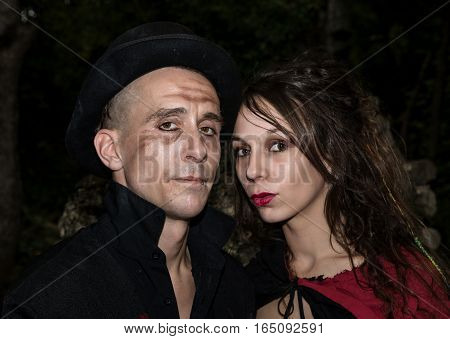 a young couple disguised as vampires on night