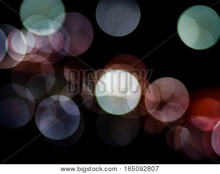 Festive abstract background and circle bokeh defocused lights with noise textured.