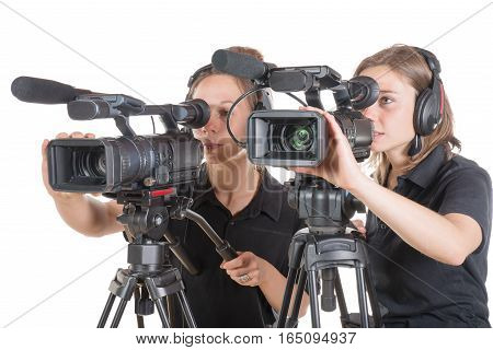 two young women with professional video camera