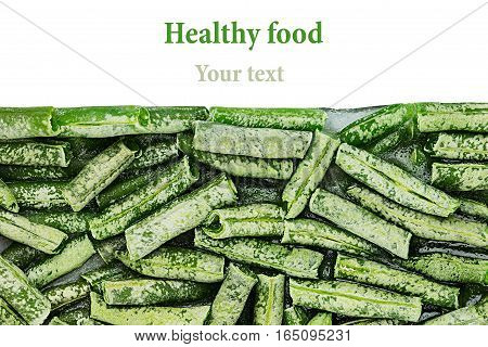 Border of fresh frozen green french bean with hoarfrost closeup on white background. Isolated. Healthy vitamin food.