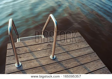 Metal stairs and wood flooring in the outdoor pool