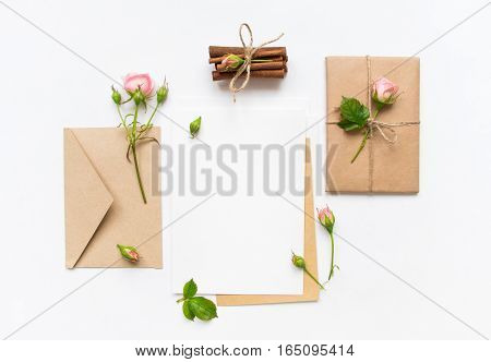 Letter, Envelope And Gift On White Background. Invitation Cards, Or Love Letter With Pink Roses. Hol