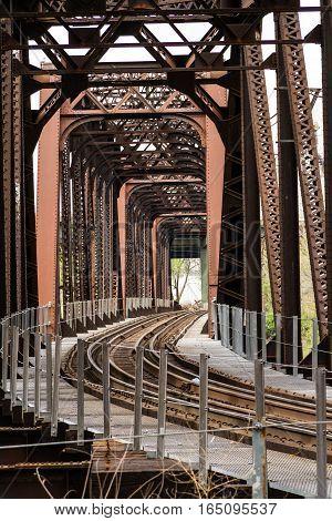 Railroad track bridge going over a river.