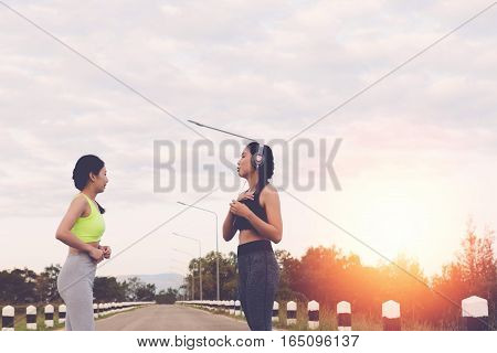 Fitness, Sport, Friendship And Healthy Lifestyle Concept - Two Happy Teenage Friends Or Sportswoman