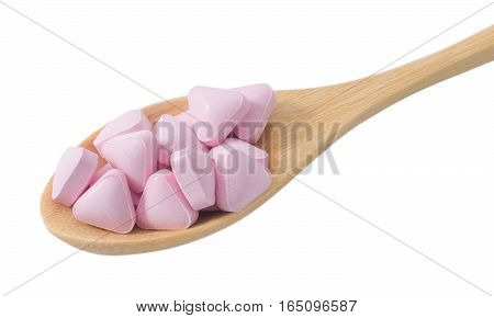Healthcare Concept Wooden Spoon Full with Vitamins Pills isolated on White Background.