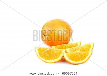 A selection of sliced oranges and a whole orange isolated against white