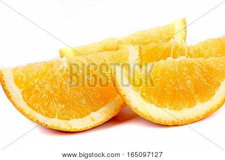 Slices of an orange isolated on white