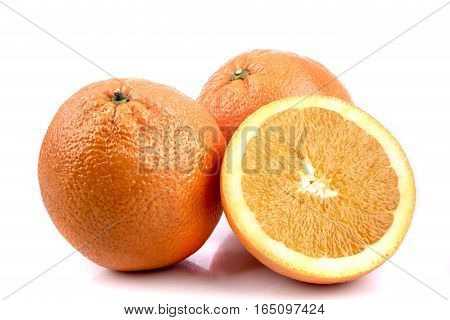 Two whole oranges and half an orange