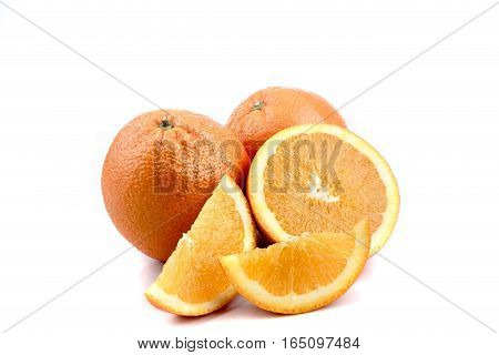A selection of oranges, whole and sliced