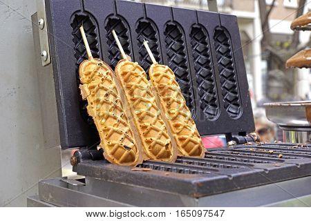 Waffle and hotdog at street food . street food waffle