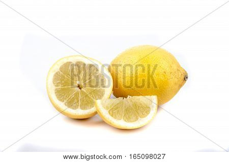 A selection of sliced and whole lemons isolated on white
