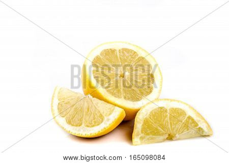 A selection of sliced lemon isolated on white