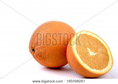 A half and a whole orange isolated