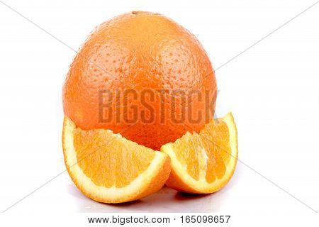 A whole orange with segments isolated on white