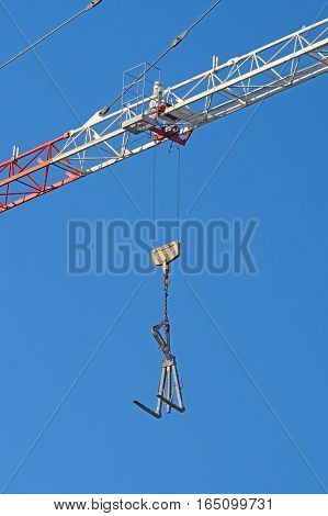 Crane boom in operation. Boom of mobile crane with blue sky background