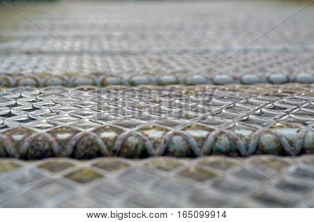 Steel plate slip old metal floor sheet, rusty steel plate texture, metallic texture, steel industry background, aluminum surfaces background, industrial shiny metal silver with rhombus shapes.