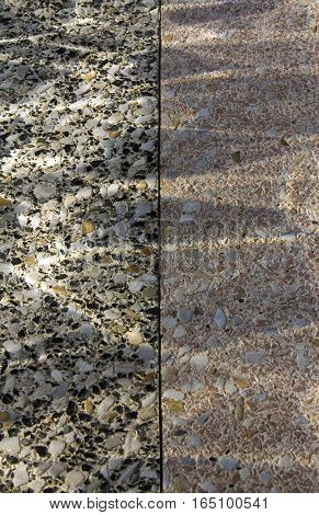 View of dual texture of Terrazo floor with reflections.