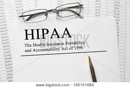 Paper with HIPAA The Health Insurance Portability and Accountability Act of 1996 on a table