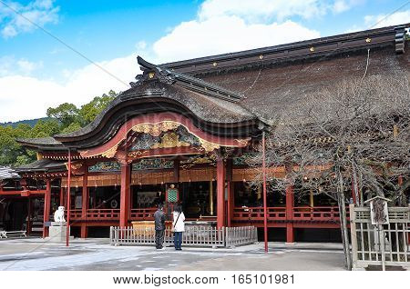 Couple praying at Dazaifu shrine in Fukuoka Japan